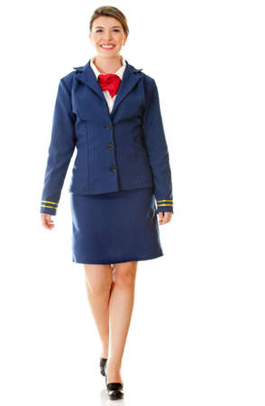 Beautiful air hostess walking - isolated over a white background photo