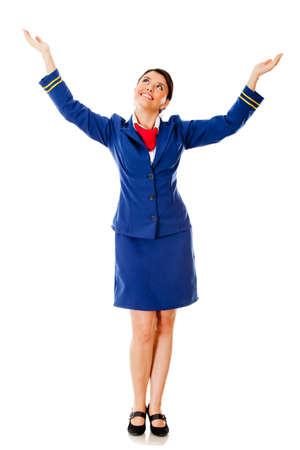 Flight attendant with arms open - isolated over a white background photo