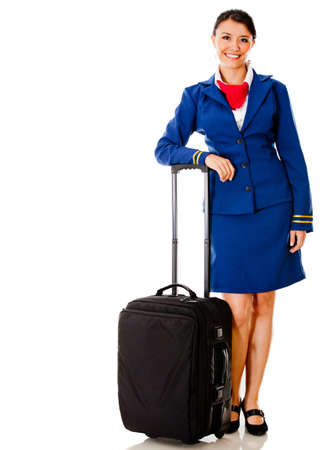 Beautiful flight attendant with her bag – isolated over white  photo