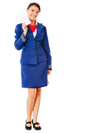 Happy air hostess holding ticket  - isolated over a white background photo