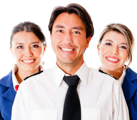 Pilot and flight attendants smiling – isolated over a white background  photo