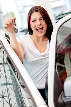 Excited woman buying a car and holding keys  photo
