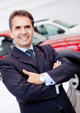 Business man at a dealership buying a car photo