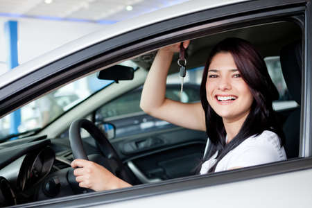 excited woman: Excited woman buying a car and holding keys