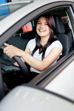 woman driving: Woman driving her new car from the dealer