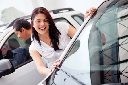 buying a car: Couple at the dealer looking for a car