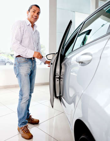 Man opening a car with his key Stock Photo - 12619651