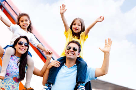 Excited family going on a family trip by airplane photo