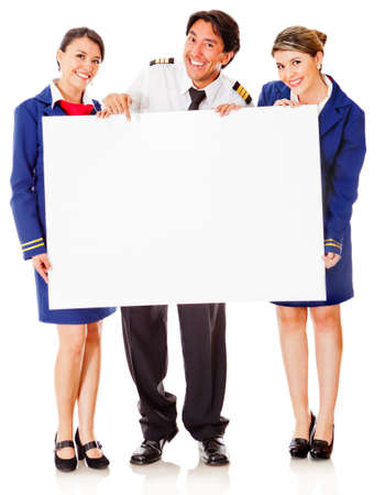 Flight attendants and pilot with a banner - isolated over a white background photo