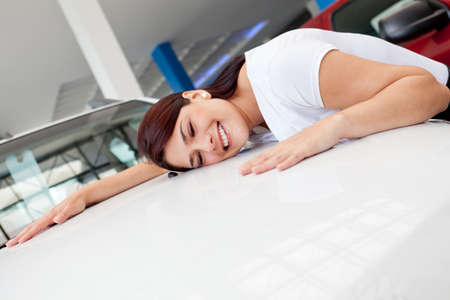 car dealer: Woman at the dealer looking for a new car to buy