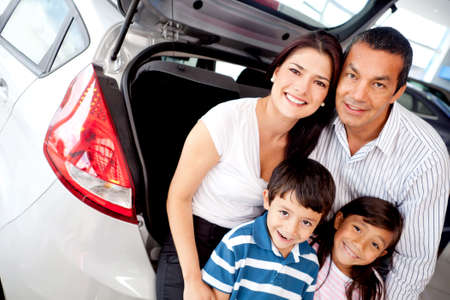car dealers: Family at the dealer buying a new car