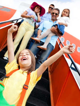 Happy kid going on holidays with his family by airplane  Stock Photo - 12824706