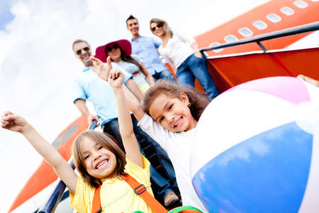 Happy kids traveling by airplane for their vacations  photo
