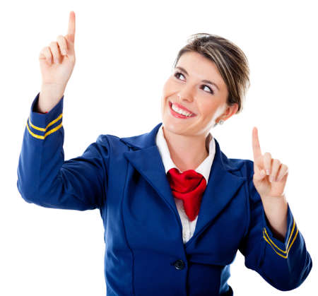 Air hostess pointing two different destinations - isolated over a white background photo
