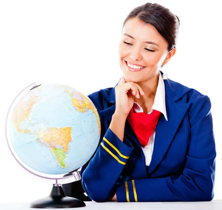 Air hostess with the globe - isolated over a white background photo