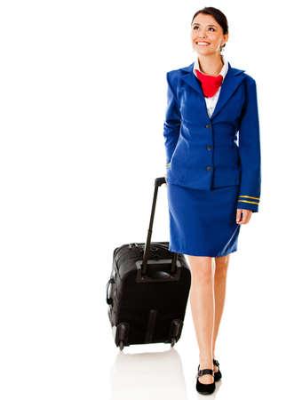 air hostess: H�tesse de l'air de marche avec son sac - isol� sur un fond blanc