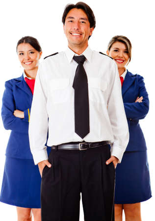 Airplane cabin crew with pilot and air hostesses - isolated over white  photo