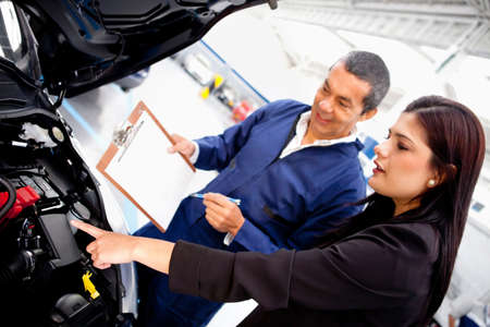 Woman taking car to the garage for mechanical checkup photo