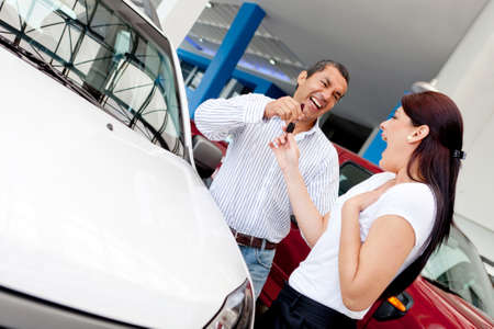 car dealers: Man buying car to his wife and giving her the keys