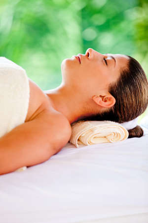 Beautiful woman lying down relaxing at a spa  photo