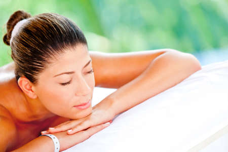 Relaxed woman lying down at an outdoors spa  photo