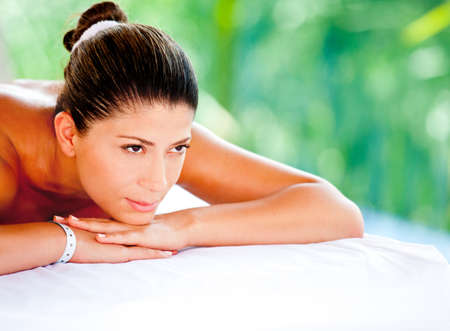 Beautiful woman lying down and relaxing at a spa  photo
