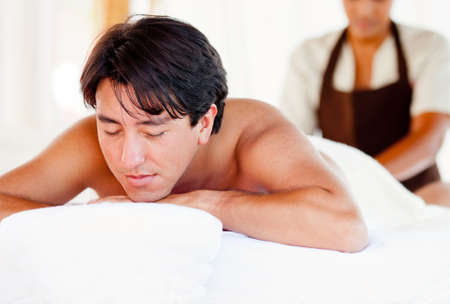 Man getting a massage on his body at the spa photo