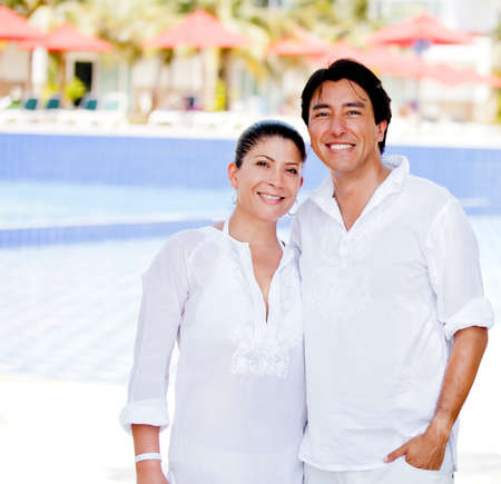 Happy couple enjoying their holidays at a resort  photo