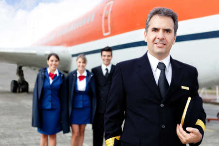 Airplane captain with crew at the airport smiling  photo