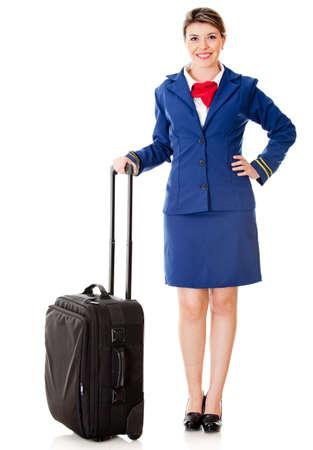 air hostess: H�tesse de l'air avec son sac pr�t pour l'embarquement - isol� sur un fond blanc