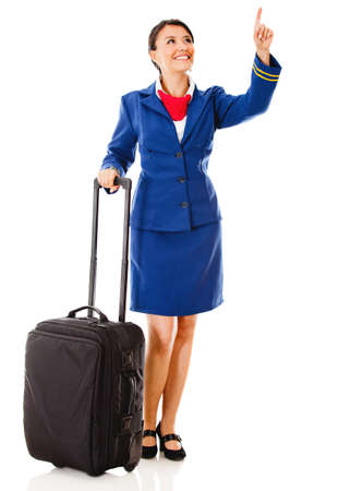 Flight attendant pointing with her finger - isolated over a white background Stock Photo - 12824691
