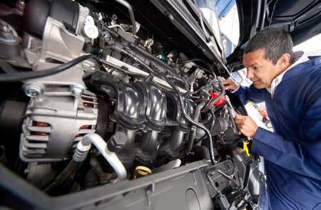 mechanical: Car at the mechanic for problems with engine