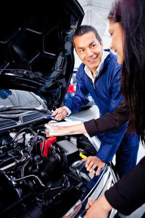 mechanic: Mechanic explaining to a woman what is the problem with her car