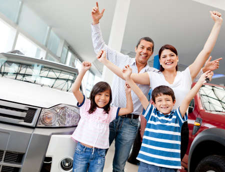 buying a car: Happy family at the dealer buying a new car