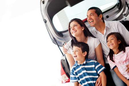 Happy family with their new car smiling  photo