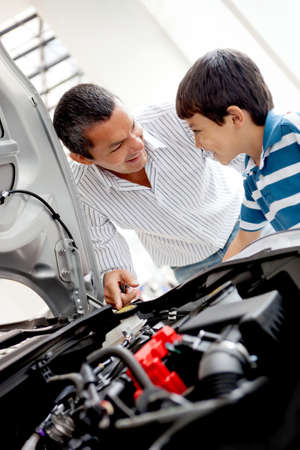 Father and son at the dealer looking at a car engine photo