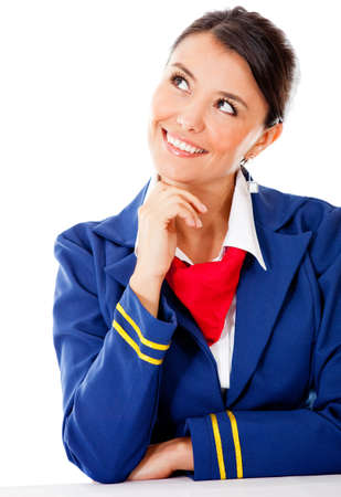 Pensive flight attendant looking up - isolated over a white background photo