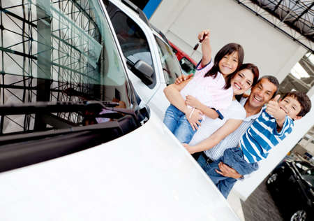 Happy family with their new car t the dealer  photo