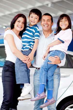 Happy family at the dealer buying a new car photo
