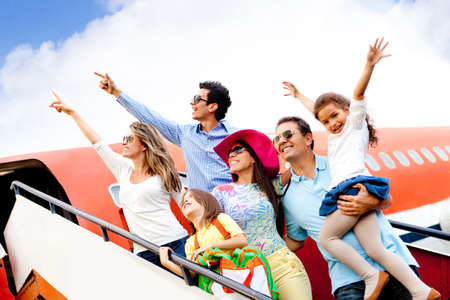 Happy group of people traveling by airplane on their holidays  photo