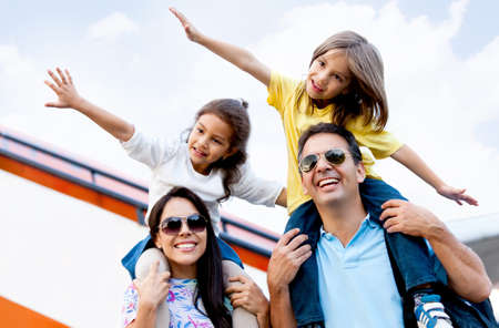 Happy family wth two kids traveling by airplane  photo
