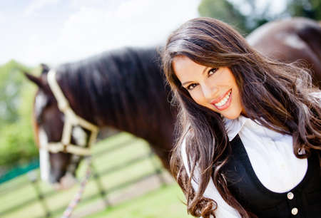 Beautiful woman portrait smiling with a horse  Stock Photo - 12824617