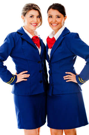 Beautiful air hostesses smiling - isolated over a white background photo