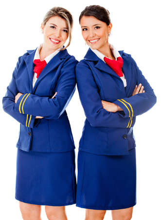 flight crew: Happy team od flight attendants smiling - isolated over a white background Stock Photo
