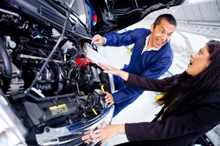 Woman taking her car to the mechanic  photo