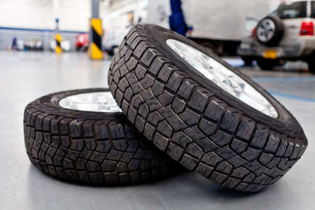 Car tires or wheels at an auto repair shop photo
