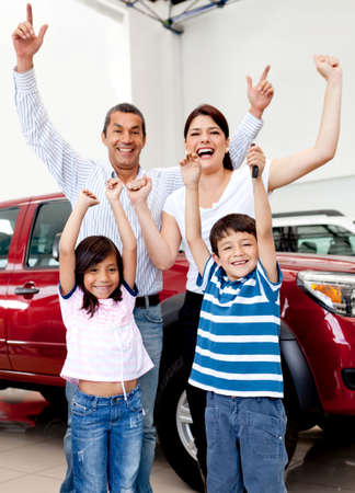 new car: Happy family at the dealership buying a new car