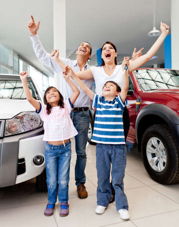 purchases: Happy family at the dealership buying a new car