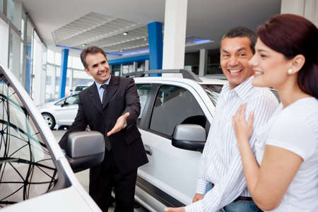 car retailer: Couple at the dealership looking for a new car  Stock Photo