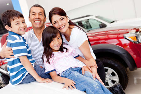 car dealers: Family out shopping for a new car at the dealership Stock Photo